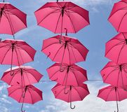 Pink umbrellas flying Stock Photo