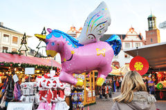 Pink unicorn balloon in Christmas market Stock Images