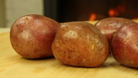 Pink unpeeled potatoes. Close-up tracking shot stock video footage