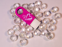 Pink USB flash drive with heart and gems Royalty Free Stock Photography