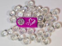 Pink USB flash drive with heart, gems on light background Royalty Free Stock Image