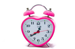 Pink Valentine alarm clock - in the form of heart isolated Royalty Free Stock Photography
