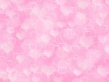 Pink valentine background with boke and hearts. Abstract pink valentine background with boke effect and hearts Royalty Free Stock Photo