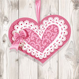 Pink Valentine card on wooden background Royalty Free Stock Photos