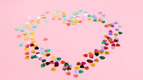 Valentine`s Day composition. Heart on pale pink background. Flat lay, top view Love concept. Pink valentine day background with hearts. Brilliant multicolored stock images