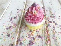 Pink Valentine`s Cupcake. Pink Valentine Cupcake decorated with sugar hearts Royalty Free Stock Photography
