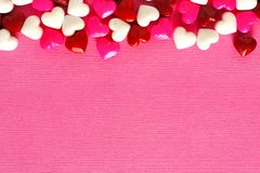 Pink Valentines Day background with candy border Royalty Free Stock Photo