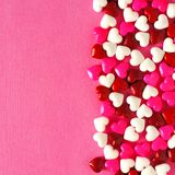 Pink Valentines Day background with candy hearts Royalty Free Stock Photos