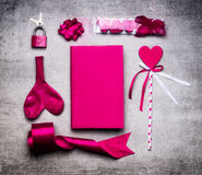 Pink Valentines day decoration tools : heart, ribbon, loop, key lock, balloon, day book on stone background, top view Stock Photos