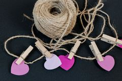 Valentines day hearts and rope. Pink Valentines day hearts on grey background Royalty Free Stock Image