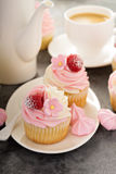 Pink vanilla and raspberry cupcakes Stock Photo