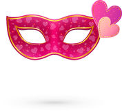 Pink vector carnival mask with hearts Stock Photos