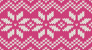 Pink vector realistic knit seamless pattern with white snowflakes and zig zag ornament Royalty Free Stock Photography