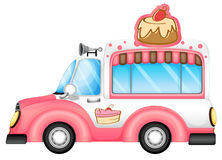 A pink vehicle selling cakes Stock Photography
