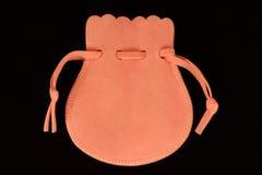 Pink velvet bag. Pink velvet on black background Stock Images