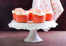Pink velvet cakes. With cream topping Royalty Free Stock Images