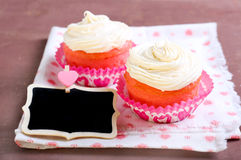 Pink velvet cakes. With cream topping Stock Photography