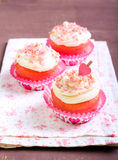 Pink velvet cakes. With cream topping Royalty Free Stock Image