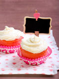 Pink velvet cakes. With cream topping Stock Images