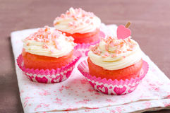 Pink velvet cakes. With cream topping Royalty Free Stock Photography