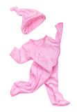 Pink velvet rompers with hat in motion Royalty Free Stock Photography