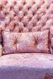 Pink velvet sofa. Close up of pink velvet sofa and cushions with vintage style stock photos