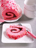Pink velvet swiss roll. With strawberry jam Royalty Free Stock Photos