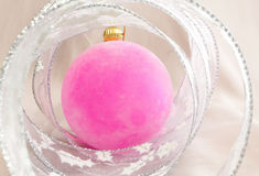 Pink velvety New Year's ball and elegant tinsel Royalty Free Stock Images