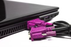 Pink VGA cable. And laptop port connecting and having another disconnected end royalty free stock photos