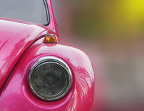 Pink vintage car headlight. A pink vintage car headlight closeup shot isolated on white background Royalty Free Stock Photography