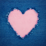 Pink vintage heart on blue denim fabric Royalty Free Stock Images