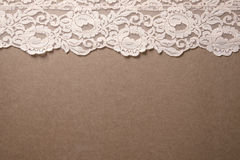 Pink Vintage Lace Trim. Light pink lace trim sits on a wooden background stock images