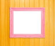 Pink Vintage picture frame on blue wood background Stock Image