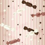 Pink vintage seamless background with candy. Vintage seamless pattern with wrapped candy and dots. The tiles can be combined seamlessly. Graphics are grouped and Stock Images