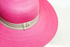 Pink vintage weave hat. Of woman in white background Royalty Free Stock Photography