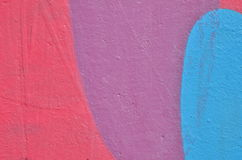 Pink, violet and blue painted wall Stock Photos