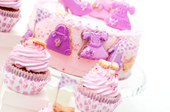 Pink and violet girl's birthday cake. On the plate Stock Photography