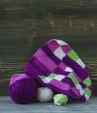 Pink, violet, magenta, white and green plaid and balls. Cotton yarn for knitting, crochet. The beginning of bright plaid, checkere Royalty Free Stock Photo
