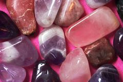 Pink and violet polished stones royalty free stock photo