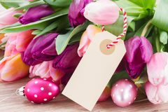 Pink and violet tulips with easter eggs Royalty Free Stock Photo