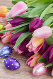 Pink and violet tulips with easter eggs Stock Image