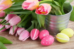 Pink and violet tulips with easter eggs Royalty Free Stock Photography
