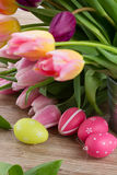 Pink and violet tulips with easter eggs Royalty Free Stock Images