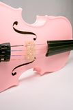The Pink Violin. A pink violin against a white background Stock Photo