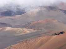 Pink vulcano hills. Pink volcano hills with clouds shadows Stock Images