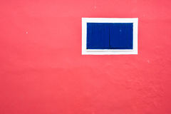 Pink wall with blue window. Stock Photo