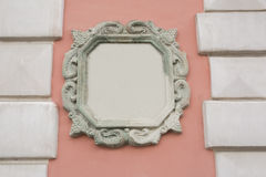 Pink wall decorated with stucco and molding. Space for text Stock Photos