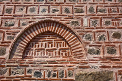 Pink Wall Detail. Stone and brick abstract background detail from an old mosque Stock Photo