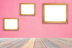 Pink wall and empty wood desk and Wooden frame .Blank space for text and images.  royalty free stock images