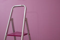 Pink wall with ladde Stock Photos